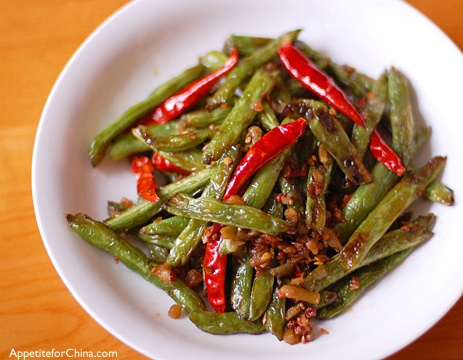 Sichuan Green Beans. I actually had this in a chinese restaurant with mushrooms and it was the best food i've ever ordered off of a chinese menu! Must try this dish