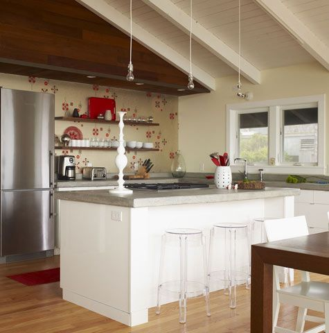 When doing an island with seating, I like the idea here of bringing out the sides to match the width of the countertops