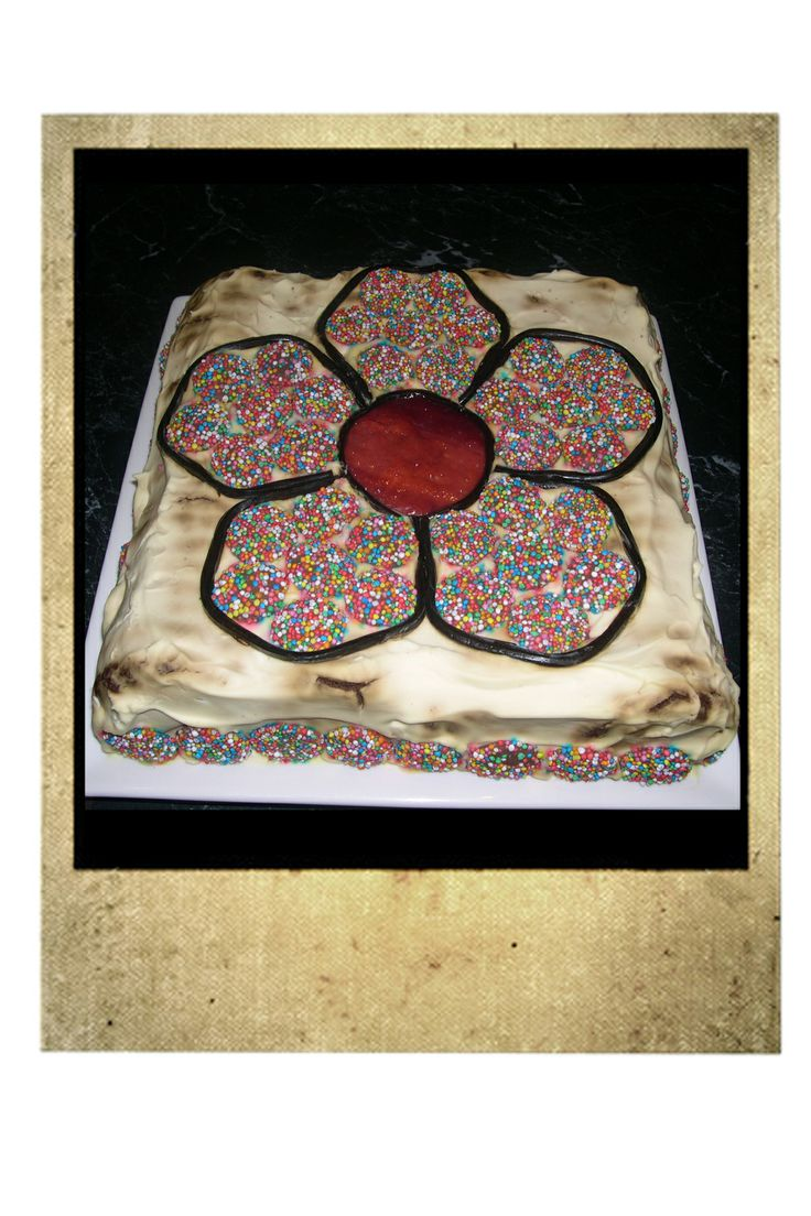 K's 4th Birthday Flower Cake.  Chocolate Ripple with cream, freckles, liquorice and fruit strap.
