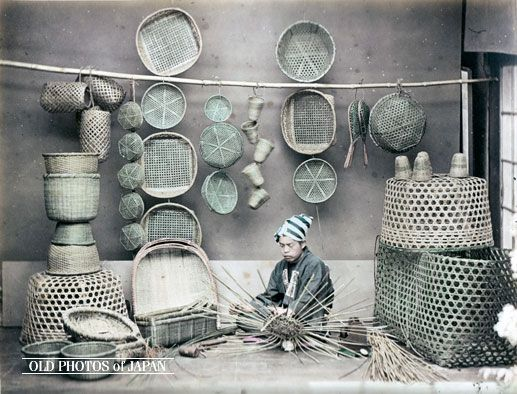 1870s post-Edo era and early Meiji Era. Basket Craftsman| A studio portrait of a young basket maker wearing a head band using bamboo to weave a basket. All around him are his bamboo products, which include draining baskets (笊, zaru), winnowing baskets (箕, mi), and noodle-draining baskets (饂飩打ち上げ篭, udon uchiage kago).