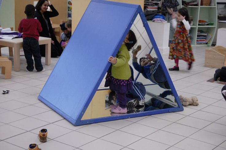 Mirror Triangle Wooden. Each child has his or her mailbox for receiving messages, gifts and invitations.  Supports and encouraging mark making and use of symbols for communication.  The trolley contains materials and a work surface, so children can independently create their own messages to friends. The satin finish to the door lets you see only the colour and shape of what's inside.