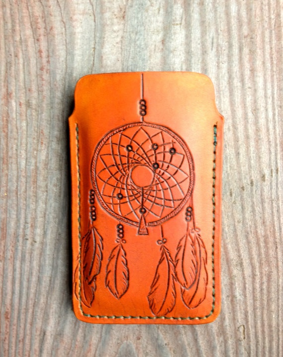 This iPhone case is 100% handmade. It was hand-cut, hand-shaped, hand-carved, hand-stamped, hand-sewn and hand-finished from Top Grade Vegetable Tanned Leather. It is also pre-shaped to fit an iPhone 4 or 4s. However, this case can also be made and shaped for an iPhone 5!  $38.00 on http://www.etsy.com/shop/TheCabinGiftShop