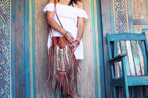 ndian leather bag large size, light brown with white choker   Bone bead choker attached as decoration  Fully lined inside with one pocket.  strap can be adjusted to several lengths.  Material: leather