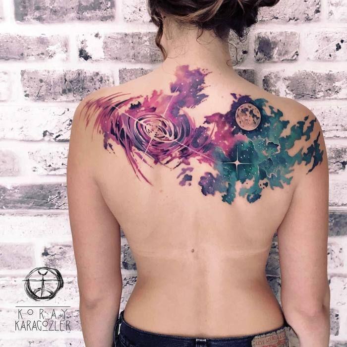 Vibrant Watercolor Space Tattoo by Koray Karagozler