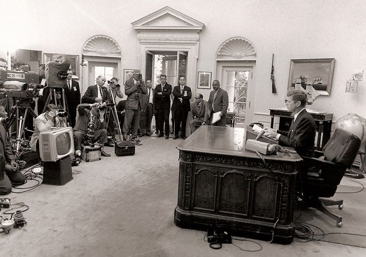 """Another preoccupation of the Kennedy White House is the struggle of African-Americans for equal treatment. On June 11, 1963, the President orders Alabama Governor George Wallace to cease and desist from obstructing black students from attending the University of Alabama. Above: That night, the President delivers a major televised address on civil rights saying, """"It ought to be possible...for every American to enjoy the privileges of being American without regard to his race or color."""""""
