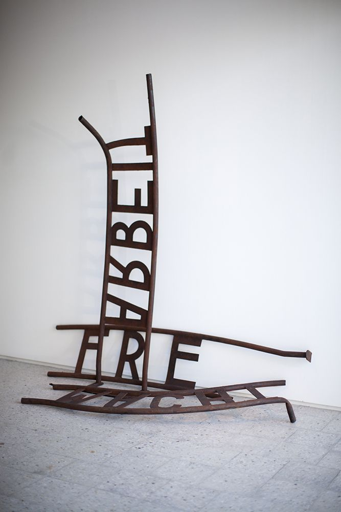 "Jonathan Horowitz's ""Untitled (Arbeit Macht Frei)"" is a replica of the notorious sign from the Auschwitz concentration camp—""work makes you free""—a saying whose grotesque irony has come to symbolise the horror of the Holocaust."