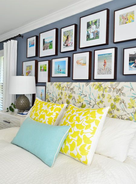 This is so similar to our bedroom... Already have the same blue walls, 2 yellow accent pillows, and white quilt. Love the white curtains, that could brighten us up a bit, and the teal pillow is cute, and THAT PHOTO WALL! Frames from Michaels. via Young House Love
