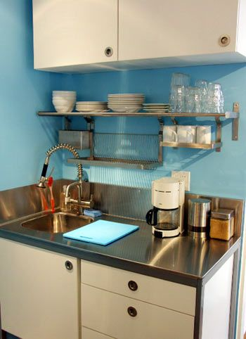 Love this simple, small sink area. No need for a drying rack, as they plates etc drip down on to the work top!