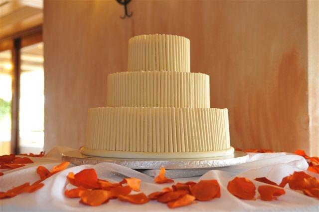 White wedding cake with white chocolate sticks by Algarve Wedding Planners   My Portugal Wedding   Portugal Luxury Weddings