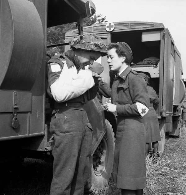 Private F. Madore with Nursing Sister M.F. Giles waiting for an air-evacuation from an R.C.A.F. Spitfire base, Normandy, France, 16 June 1944. #ww2 #cdnhistory
