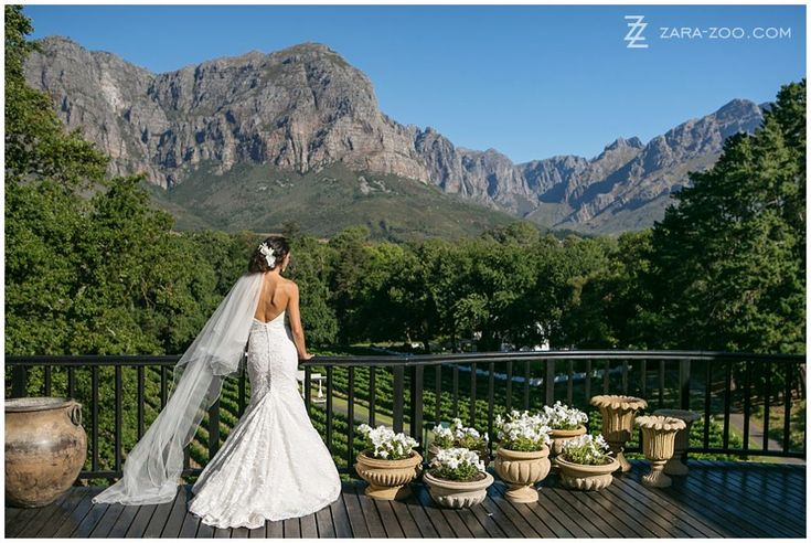 """Molenvliet Wine Estate in Stellenbosch is one of our favourite #wedding #venues.  From the pool balcony of the """"Residence"""" you have the most amazing elevated view of the vineyards below and the Franschhoek mountains in the distance.  See more of this wedding here http://www.zara-zoo.com/blog/fresh-wedding-ideas-molenvliet/"""