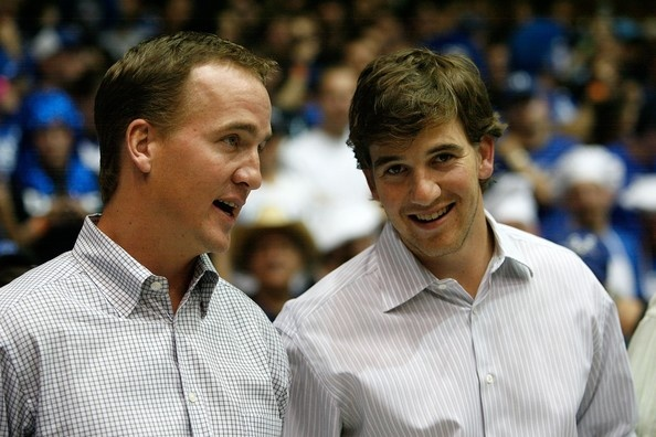 Peyton Manning and Eli Manning attending the Duke-Carolina game in Cameron Indoor Stadium.