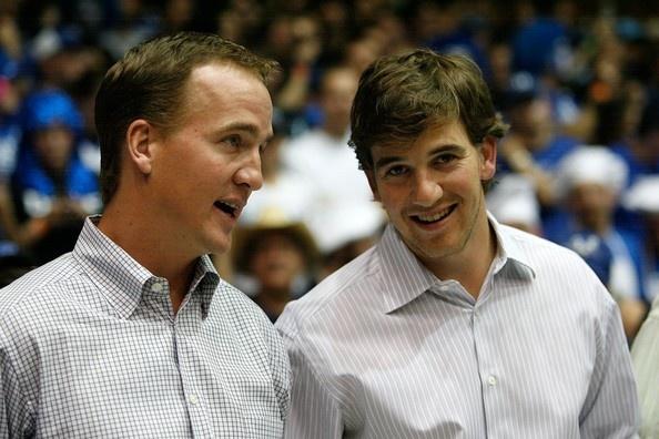 Peyton Manning and Eli Manning attending the Duke-Carolina game in Cameron Indoor Stadium.