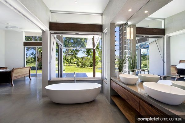 A beautiful open plan bathroom with a view.