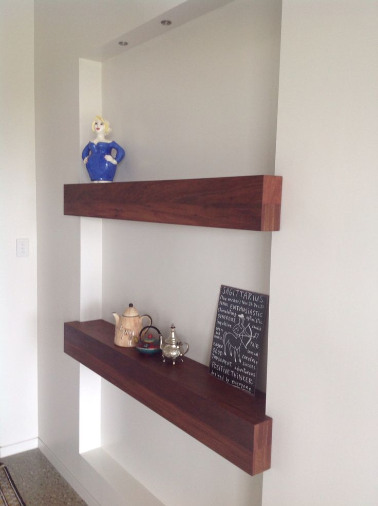 Wall niche with a couple a hardwood shelves.