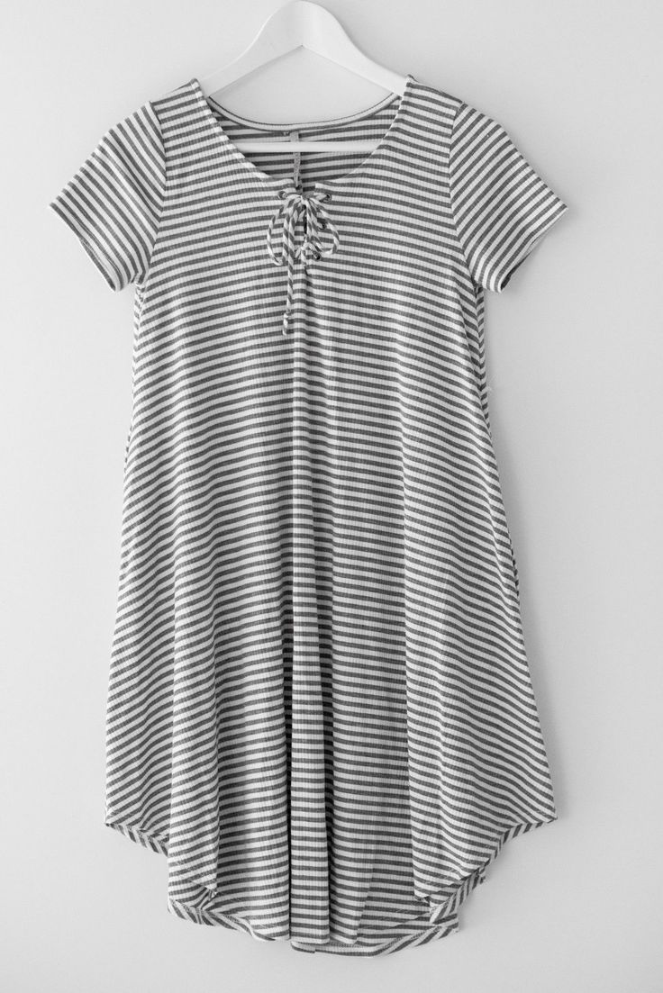 """Grey and white thin striped dress with a lace up front and side pockets. Made with stretchy ribbed knit material. A-line silhouette and a loose fit. Size small shortest hem measures approx. 30"""" in len"""