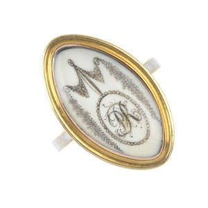 LOT:9 | A Georgian gold ivory and enamel mourning ring.