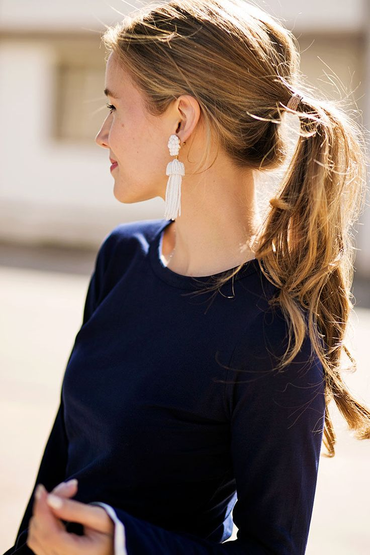 Statement earrings & Ponytail.