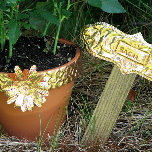 Make your own copper garden art to repel slugs:  http://www2.fiskars.com/Activities/Gardening/Art-in-the-Garden/Garden-Decoration-and-Markers#