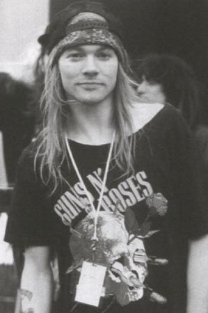 I was in love with Axl Rose back in the 90s when i was about 10.   I used to wear kilts and band tshirts just like him.   (i still do hehehe!!!)