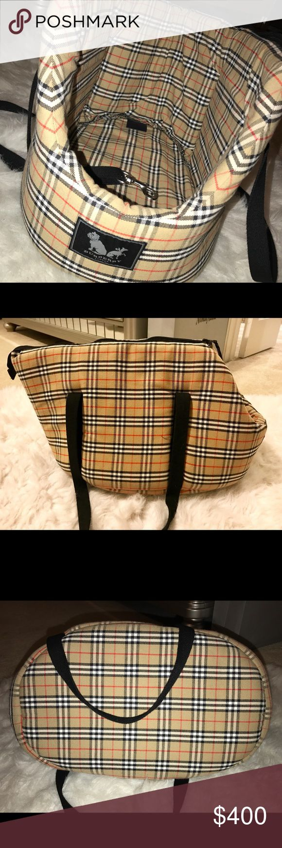 Burberry Pet Carrier We bought this for our yorkie because we thought we'd need to use it at some point but he's never been in it even once just to try it out! Even though he never went in it, it looks like he would fit perfectly. So I would have to GUESS it could hold a pet up to 10lbs but I cannot say for sure.  Therefore, it's really like new as there are no signs of wear. So if you have a pet who might appreciate a carrier like this one, it really is super cute and probably pretty comfy…