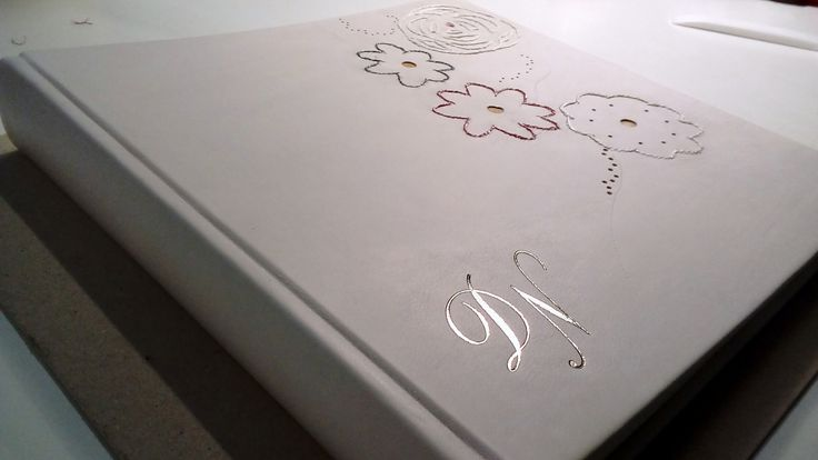 Wedding photo album. Embroidery on leather, hot foil blocking