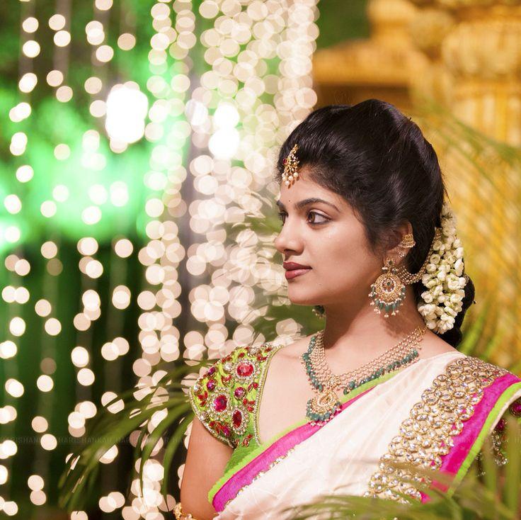 South Indian bride. Gold Indian bridal jewelry.Temple jewelry. Jhumkis. White silk kanchipuram sari.Braid with fresh flowers. Tamil bride. Telugu bride. Kannada bride. Hindu bride. Malayalee bride.Kerala bride.South Indian wedding.