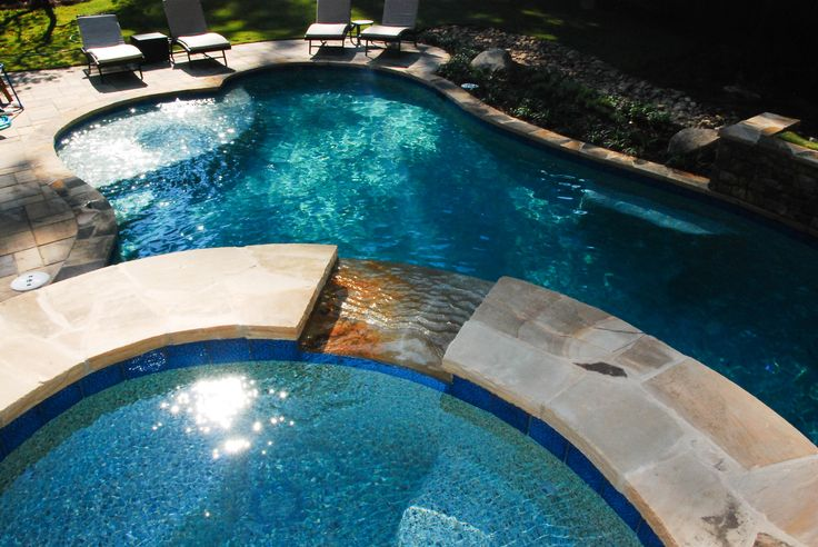 A Beautiful Spill Over From Spa Into The Pool By Peach State Pool Builders Spas Hot Tubs