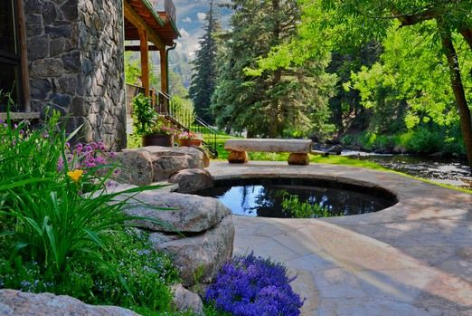 Evergreen Residence  The hot tub area features local stone, pavers and beautiful vistas