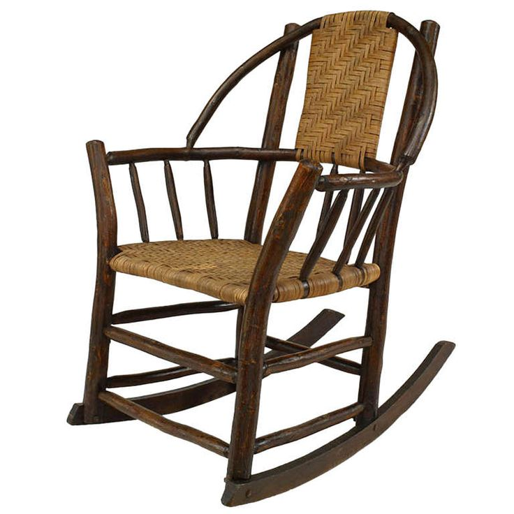 Attributed to the esteemed Old Hickory Furniture Company, this rocking armchair features a hoop back and a rattan splat back and seat. The piece is branded Rustic Hickory Furniture Co. Laporte Ind. 1902-1934 $1,850