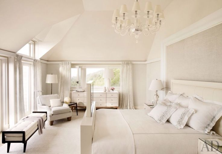 Traditional Master Bedroom With Clear Glass Chandelier High Ceiling Chair Rail Carpet French
