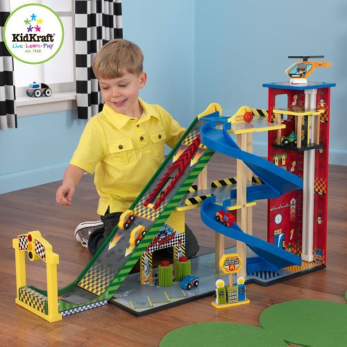 Mega Ramp Racing Wooden Play Set ~ This wooden play set by KidKraft has everything that a young car enthusiast could want - a mega ramp which launches cars up into the air, a parking garage, car wash and petrol station...!  This racing ramp will give your children hours of entertainment with its interactive features such as a countdown system, working starting ramp, working car wash and car lift, and has a three level car ramp, helipad, petrol pumps and five cars. £124.99