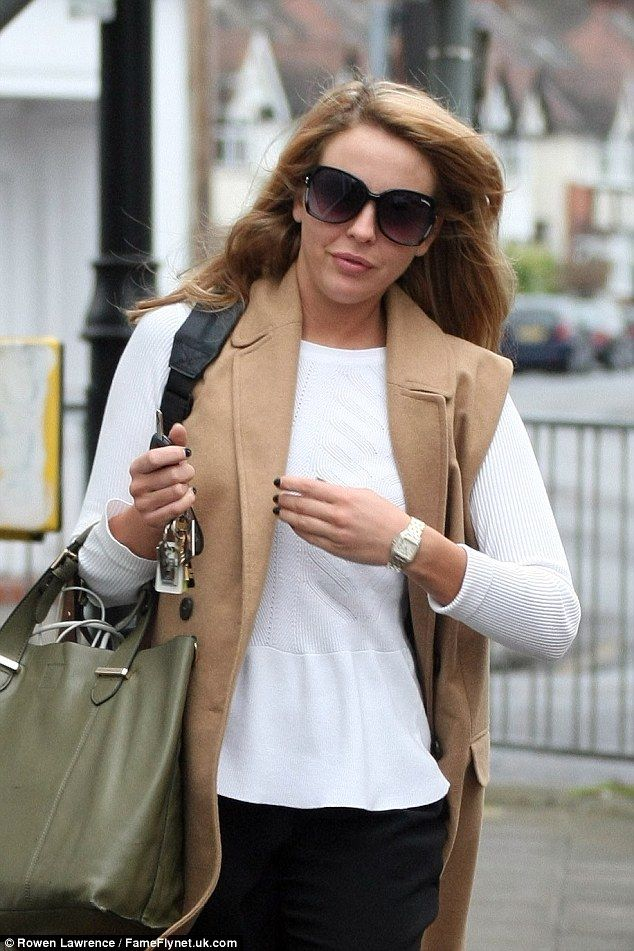 Fashion princess: She teamed the number with a white peplum jumper and black turn-up jeans...