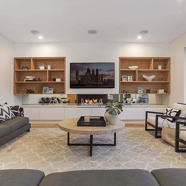 Creating inbuilt cabinets like these around your television maximises your living room wall space, makes the whole room less centered around the TV while also being practical for a family. Great design and practical spaces are one of the things that we pride ourselves on here at Pinnacle Plus. #pinnacleplus #interiordesign #loungeroom #property #realestate #design #designer #interiors #loungeroom #tv #television #shelving #bookshelves