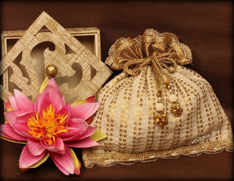 RD 1049-Mogra Beige and gold sequined potli. Cool and refreshing.                        Price: Rs. 1990