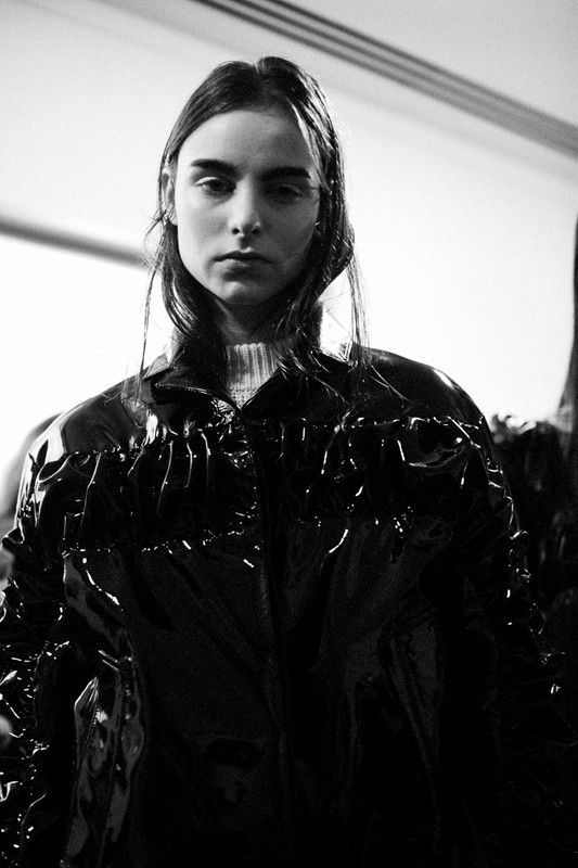 Black patent nylon ruched coat at Christopher Kane AW14 PFW. More images here: http://www.dazeddigital.com/fashion/article/19141/1/top-ten-aw14-details