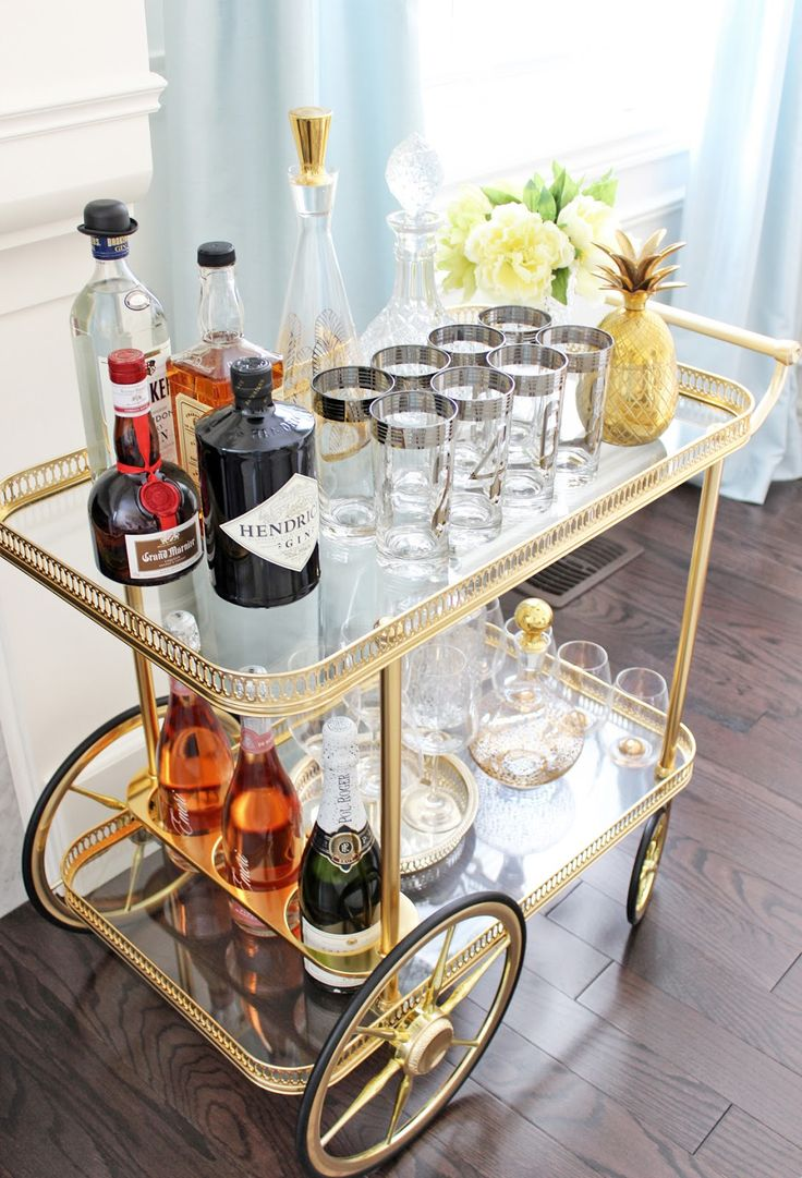 Regency style bar nook, AM Dolce Vita: Vintage Bar Cart Styling, silver-rimmed numbered Tom Collins highball glasses, mid century mod silver rim glasses, vintage barware, brass pineapple ice bucket, Maison Bagues brass bar cart