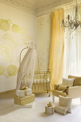 Yellow is used adorably in this gender neutral nursery.