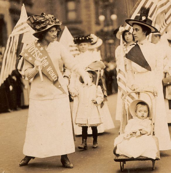 Women's Suffrage gives women the right to vote. It was the 19th amendment and established in 1920. This event changed women's roles and was very revolutionary. This photo is a parade for women's suffrage.