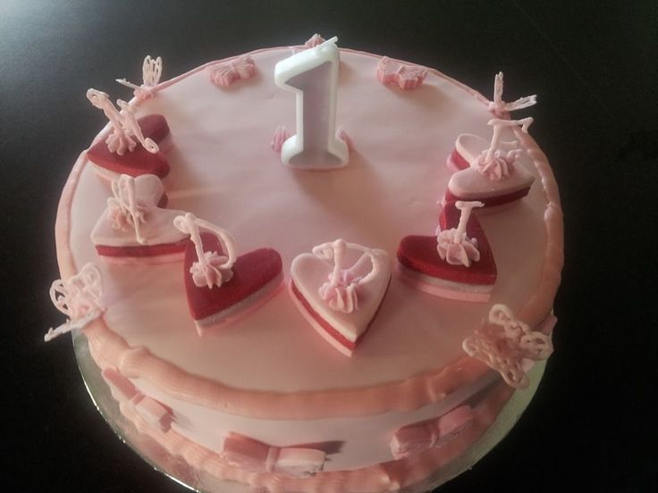 Pink butter cake with strawberry frosting and white chocolate ganache