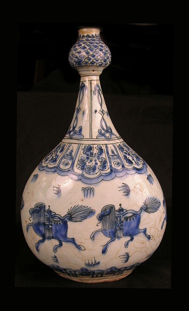 Bottle with Running Quadrupeds - 17th century, Iran - Stonepaste; painted in blue under transparent glaze