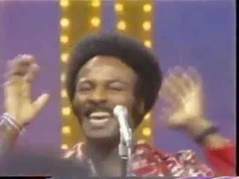 I will always relate this song to the jet plane crash tragedy into an apartment building in my hometown.  The song was playing on the car radio.  The O'Jays   Love Train