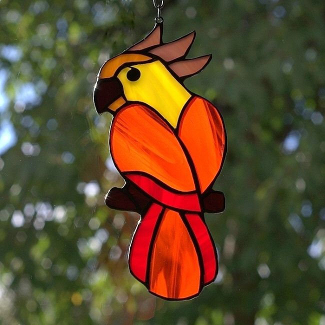 Stained glass parrot - tiffany glass bird. A stained glass suncatcher. by AmberGlassArt on Etsy https://www.etsy.com/listing/227607830/stained-glass-parrot-tiffany-glass-bird