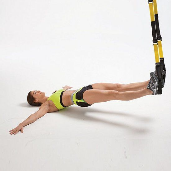 "Hamstring Pull-In: Lie face up with your heels in the TRX's foot cradles, legs extended and arms straight out to sides in a ""T,"" palms on floor. Lift hips, so body is aligned from shoulders to heels. Bend knees, pulling handles toward you. Extend legs to starting position. Sets: 3 Reps: 30 seconds"