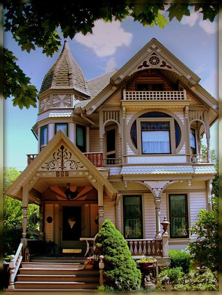 Gorgeous, I think this is a queen anne victorian...from what I remember from my middle school architecture class.