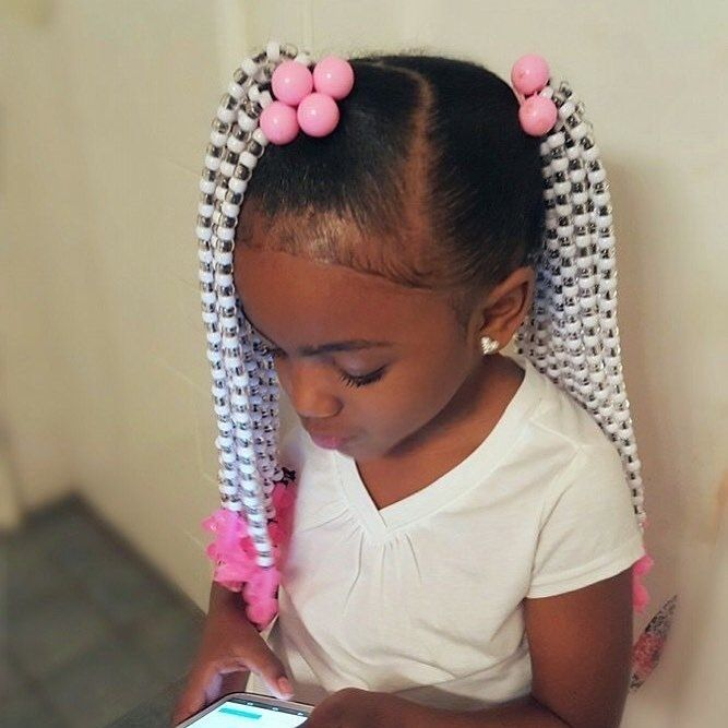 Little Black Girl With Hair Styled Into Two Ponytails Covered In Accessories Black Kids Hairstyles Kids Hairstyles Kids Braided Hairstyles