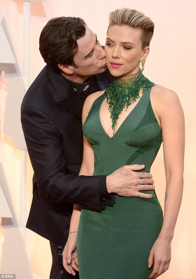 Don't mind if I do: Scarlett Johansson was taken aback by a very affectionate John Travolt...