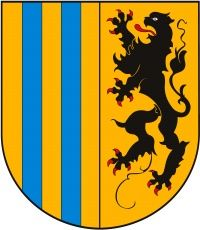 Chemnitz is a city in Saxony, Germany. Its coat of arms features a shield which is divided vertically into two sections. The left section features alternating yellow and blue stripes. The right section features a black lion on a yellow background.