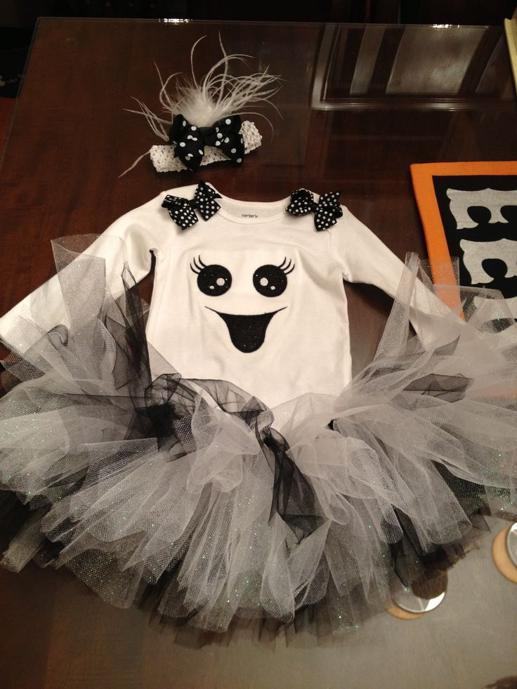 Buy halloween shirt, sew layers of tulle on bottom for skirt/tutu, pair with halloween tights