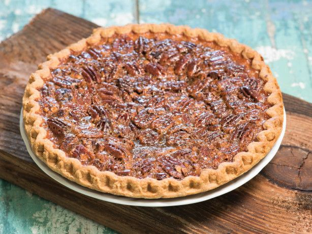 The secret to this rich pie is cooking the sugar and corn syrup first. It is definitely not diet food! I bake this pie for 45 minutes according to my oven but you may need to bake longer.